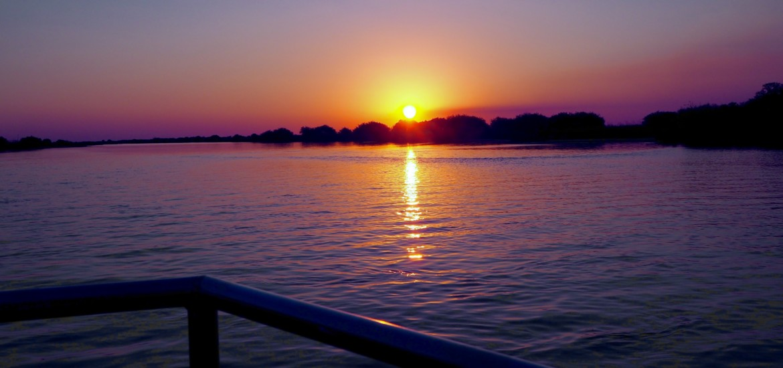 Namibia Okavango Hakusembe Lodge Fluss Strand Sonnenuntergang Sunsetcruise